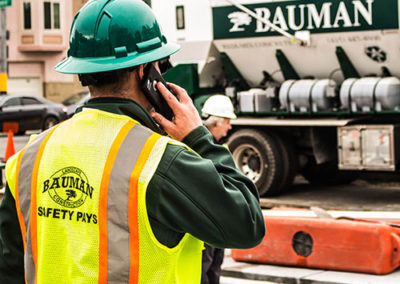 Spencer-Bauman-Worker-On-Cell-Phone-At-Work-Site